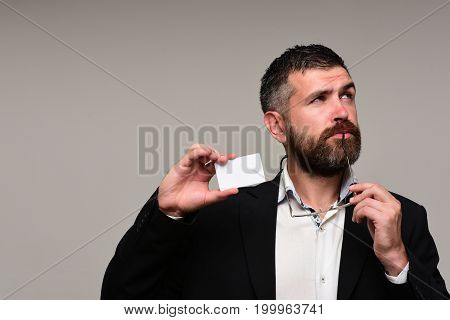 Guy With Thinking Face And Glasses On Grey Background