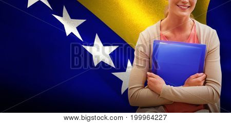 Teaching student smiling at camera against bosnia herzegovina national flag