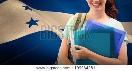 Smiling student against digitally generated honduran national flag