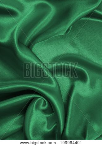 Smooth Elegant Green Silk Or Satin Luxury Cloth Texture As Abstract Background. Luxurious Background