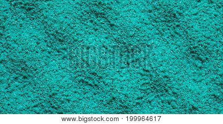 Close-up of an uneven turquoise sponge texture