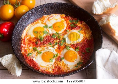Shakshuka With Bread On A Wooden Table. Middle Eastern Traditional Dish. Homemade. Selective Focus.
