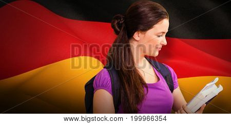 Happy student against digitally generated german national flag