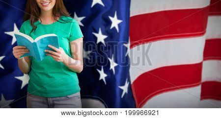 Student picking a book from shelf in library against flag with stripes and stars