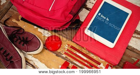 Back to school text with hashtag  against high angle view of bag with tablet and shoes on table