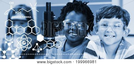 Graphic image of chemical formulas against kids doing experiment on microscope in laboratory
