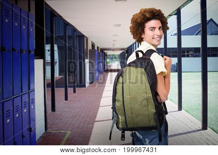 Casual young man in office corridor against empty corridor at school