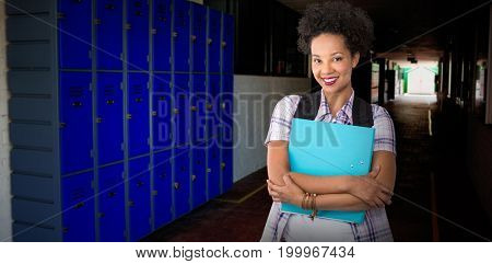 Casual young woman with folder in office against purple lockers in corridor