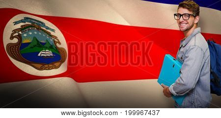 Student smiling at camera in library against costa rica national flag