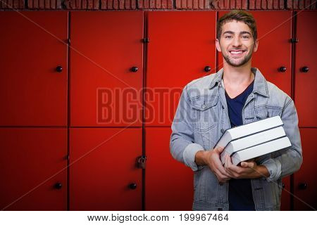 Student smiling at camera in library against close-up of orange lockers