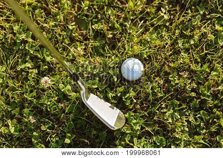 Close-up of golf ball with golf club right before tee off