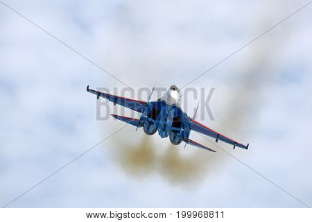 Kubinka, Moscow Region, Russia - April 5, 2011: Sukhoi Su-27 of russian knights aerobatics team jet fighter showing demonstartion flight at Kubinka air force base.
