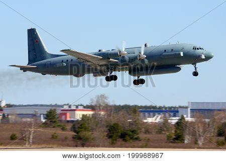 Zhukovsky, Moscow Region, Russia - February 13, 2014: Ilyushin Il-20M 90924 reconnaissance airplane takes off at Zhukovsky.
