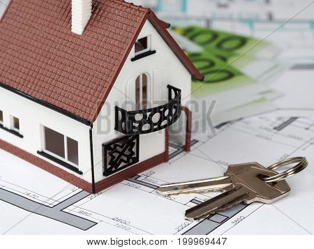 Toy House And Keys On Building Plan