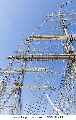 Tall sailing ship masts with ropes and flags