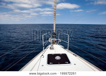 The sea view from the front of the yacht, in the summer, blue sky with clouds