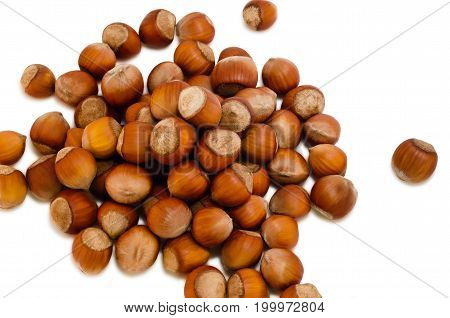 A lot of nuts scattered on a white background.