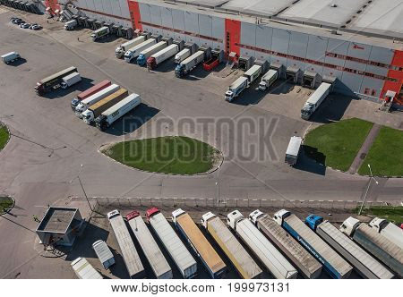 Russia, Saint-Petersburg, August 2017 - aerial view of trucks loading at logistic center