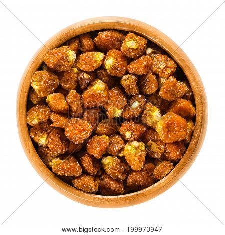 Physalis fruits in wooden bowl. Dried orange groundcherries, also called Inca berries, Cape gooseberries, poha or golden berries. Physalis peruviana. Macro food photo close up from above over white.