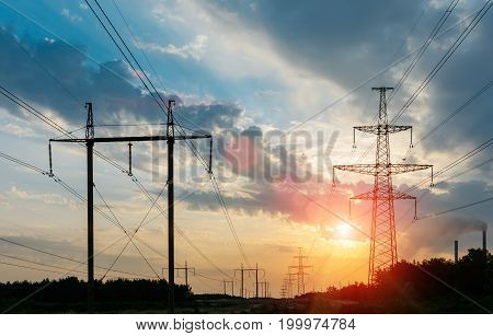 Silhouette of high voltage power lines and beautiful sky