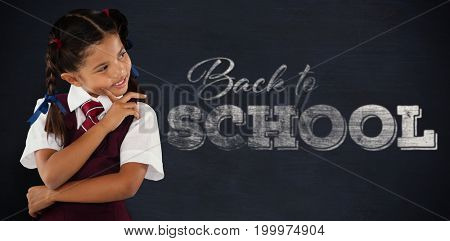 Thoughtful schoolgirl over white background against black background