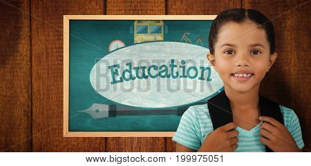 Portrait of smiling girl with bag against education against green chalkboard