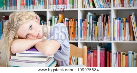Tired teeenager sleeping in a library against shelf of books