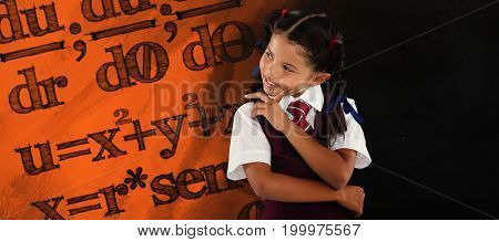 Thoughtful schoolgirl over white background against black