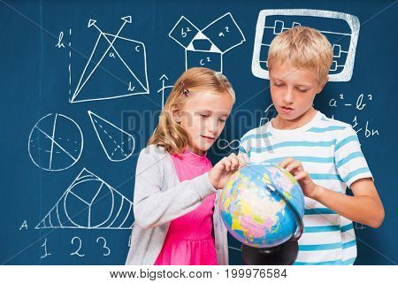 Friends looking at globe against blackboard with copy space on wooden board