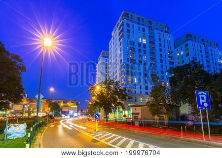 GDANSK, POLAND - AUGUST 11, 2017: Architecture of Quattro Towers in Gdansk Wrzeszcz at night, Poland. This four towers skyscraper is residential building with modern apartments in Gdansk.