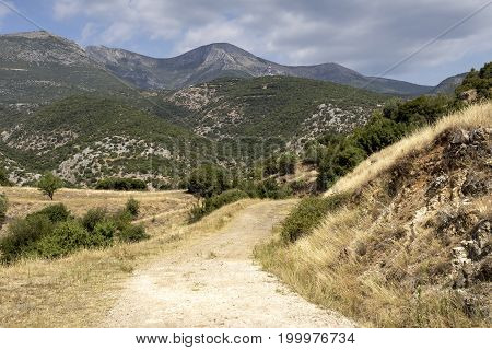 The view of the countryside, mountains and dirt road