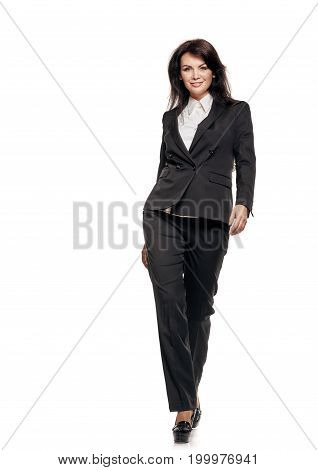 Full portrait of confident business woman in formalwear on white background