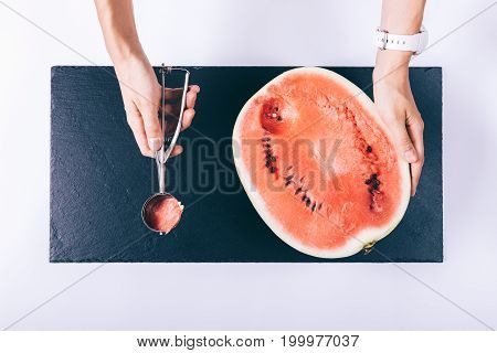 Women Hands Sliced Watermelon Spoon On White Table