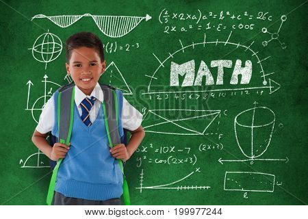 Portrait of schoolboy carrying schoolbag against white background against close-up of blackboard