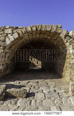 Ancient roman building remnants in Caesarea harbor national park