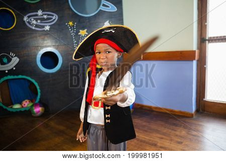 Boy pretending to be a pirate at home