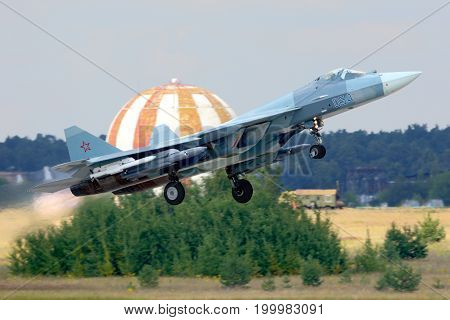 Zhukovsky, Moscow Region, Russia - July 18, 2014: Sukhoi T-50 PAK-FA 054 WHITE of russian air force performing test flight with missiles at Zhukovsky.