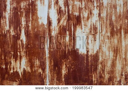 Rusty iron with remains of an old paint abstract background
