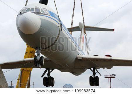 Sheremetyevo, Moscow Region, Russia - April 29, 2015: Former Aeroflot Ilyushin IL-62M RA-86492 putting on a plinth with kranes at Sheremetyevo international airport.