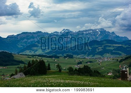 Going for a hike on a cloudy day to the swiss alps