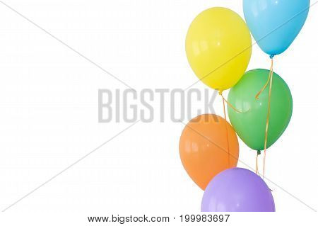decoration for birthday, holiday, joy concept - brightly colored inflated balloons on ribbons, five colors, blue, yellow, green, orange, violet, copy space, copyspace, isolated on white background
