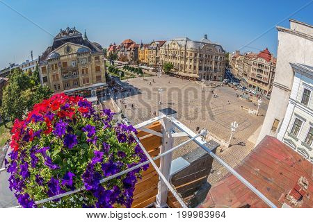 TIMISOARA ROMANIA - AUGUST 16 2017: Aerial view from one terase of historic buildings from Victory Square.
