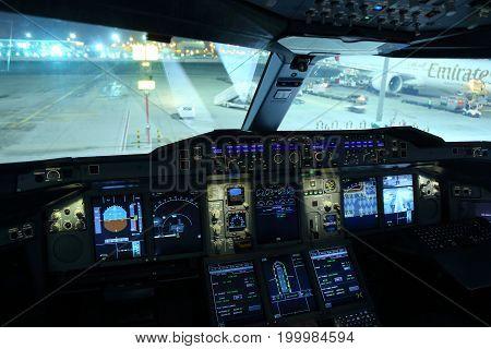 Dubai, United Arab Emirates - June 20, 2014: Emirates Airbus A380 cockpit showed at Al Maktoum international airport.