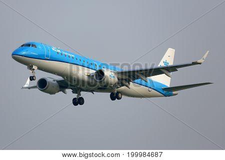Amsterdam, Netherlands - June 5, 2014: KLM Cityhopper Embraer ERJ-190STD PH-EXD landing at Schiphol airport.