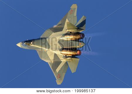 Zhukovsky, Moscow Region, Russia - August 20, 2015: Sukhoi T-50 PAK-FA 054 BLUE of russian air force perfoming demonstration flight in Zhukovsky during MAKS-2015 airshow.