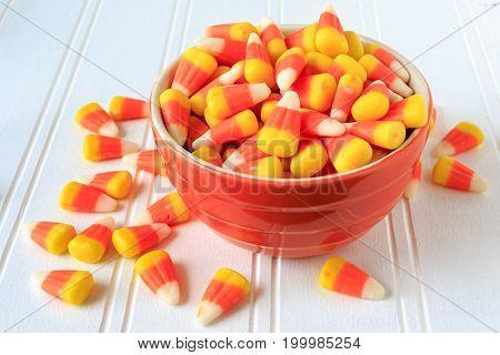 Candy corn in a ceramic bowl.