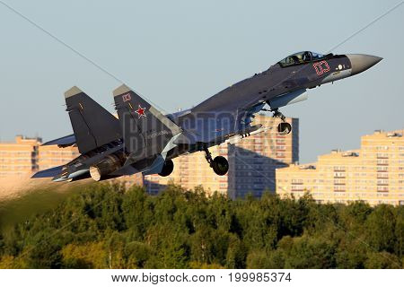 Zhukovsky, Moscow Region, Russia - August 20, 2015: Sukhoi Su-35 RF-95242 of russian air force perfoming demonstration flight in Zhukovsky during MAKS-2015 airshow.