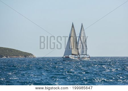 Boats in sailing regatta on the sea. Luxury yachts.