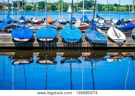 Rent sailboats on the pier. Alster lake. Hamburg Germany.