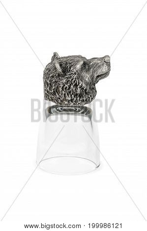 Decorative glasses for vodka with a bottom in the form of a bear head, inverted, isolated on a white background